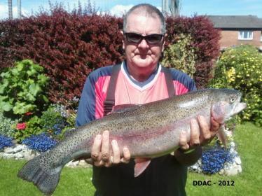 John Pickett with his 9lb 10oz Rainbow