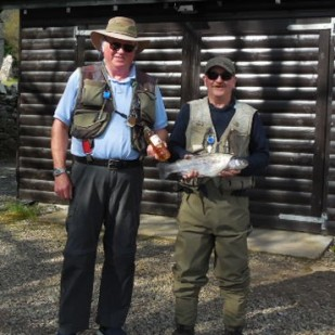 President Davy Landsburgh presenting prize to Ron Ganley for biggest fish